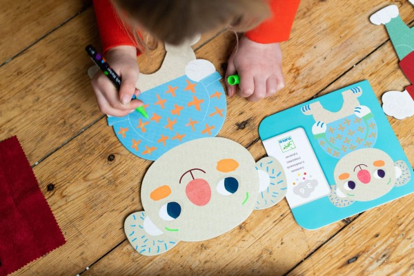 Child completing craft subscription
