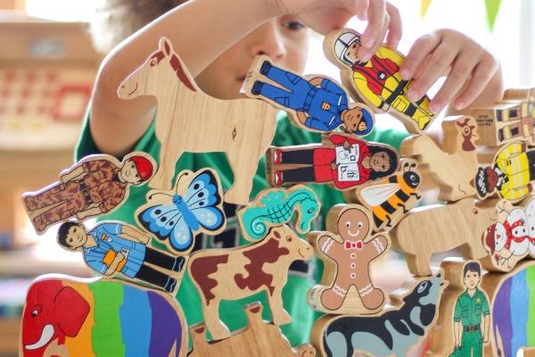 Young boy playing with Lanka Kade Toys